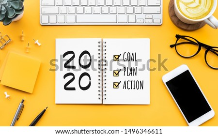 2020 new year goal,plan,action text on notepad with office accessories.Business motivation,inspiration concepts ideas Royalty-Free Stock Photo #1496346611