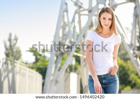 Woman in stylish t-shirt outdoors #1496402420