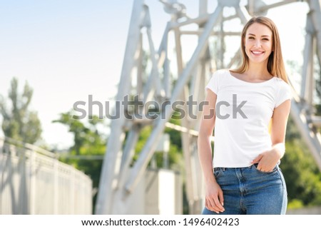 Woman in stylish t-shirt outdoors #1496402423