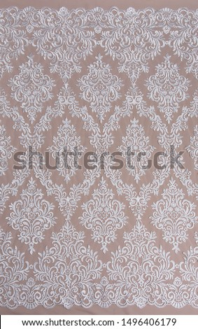 Texture lace fabric. lace on white background studio. thin fabric made of yarn or thread. a background image of ivory-colored lace cloth. White lace on beige background. #1496406179