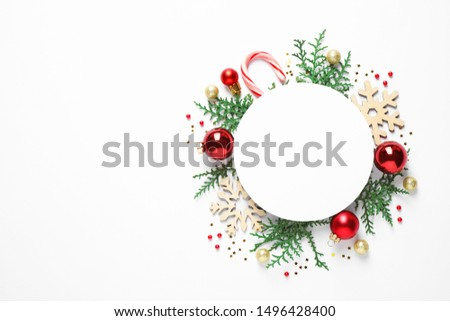 Flat lay composition with Christmas decor and blank card on white background. Space for text #1496428400