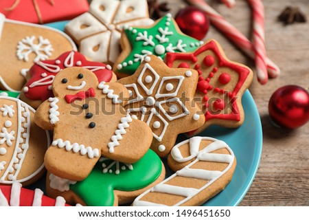 Tasty homemade Christmas cookies on blue plate, closeup view #1496451650