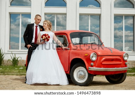 Beautiful loving wedding couple registers a marriage and walks along the beautiful promenade. Happiness and love in the eyes of men and women. Russia, Sverdlovsk, June 15, 2019 #1496473898