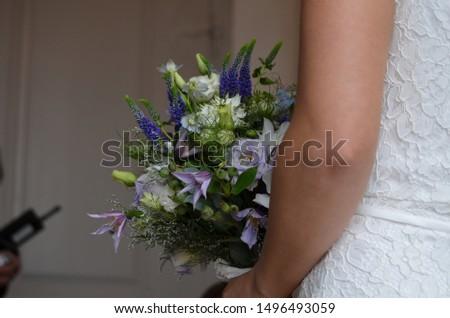 Bride with a wedding bouquet #1496493059