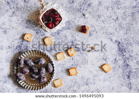 homemade plum jam and fresh plums on a blue background #1496495093