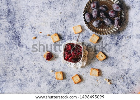 homemade plum jam and fresh plums on a blue background #1496495099