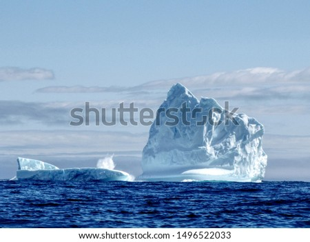 An iceberg is a piece of ice that has become detached from its parent glacier by a process known as calving. In Canada, icebergs mainly originate from west Greenland glaciers and travel south along  #1496522033