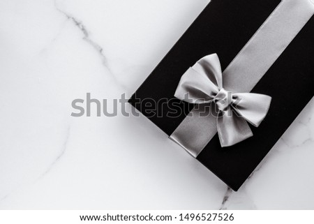 Present for him, shop sale promotion and anniversary celebration concept - Luxury holiday gifts with silver silk ribbon and bow on marble background #1496527526