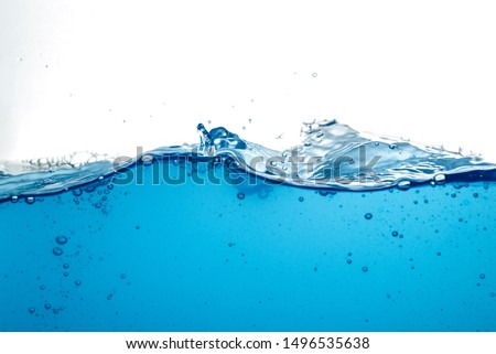 blue water surface with splash, waves and air bubbles on white background Royalty-Free Stock Photo #1496535638