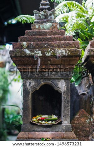 A stone monument as a place to put offerings for worship in the Hinduism of Bali. Cultural and historical image #1496573231