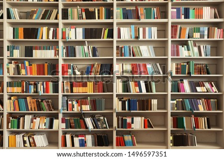 View of shelves with books in library #1496597351