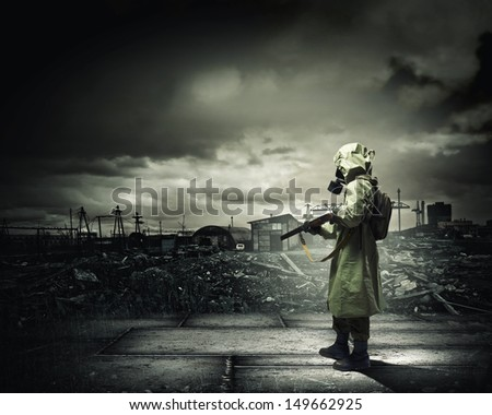 Man in gas mask and camouflage holding gun. Disaster concept #149662925