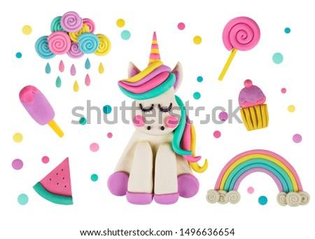 A magic unicorn made of clay on blue #1496636654