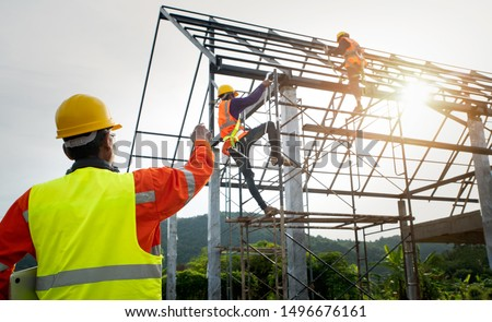 Engineers orders for workers working according to the plan. Construction labor working with accuracy concept #1496676161