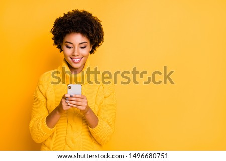 Copyspace photo of cheerful cute charming girlfriend browsing through her smartphone wearing pullover addicted to social media isolated with vibrant color background #1496680751