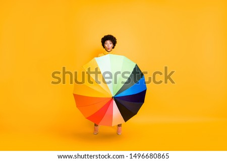 Hurricane took me by surprise concept. Full length photo of astonished staring looking with big eyes girl trying to hold open big umbrella in hand on a windy day isolated vibrant background