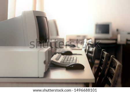 Image of a room with old computers stylized as an old photo with soft focus