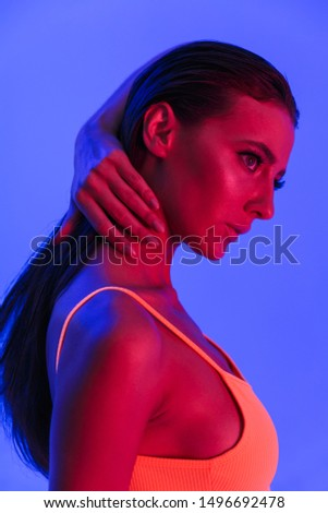 Image of adorable caucasian woman wearing bodysuit underwear posing at camera isolated over violet neon background #1496692478