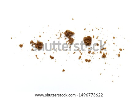 Scattered crumbs of chocolate chip butter cookies on white background. #1496773622