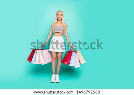 Full length body size view of nice-looking attractive slim fit thin cheerful confident glad straight-haired girl carrying new things weekend isolated on bright vivid shine green turquoise background #1496791568