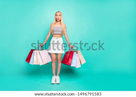 Full length body size view of nice attractive lovely gorgeous slim fit thin cheerful funky amazed straight-haired girl carrying new things isolated over bright vivid shine green turquoise background #1496791583