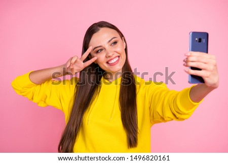 Photo of attractive charming cute gorgeous nice pretty lovely girlfriend taking selfie influencing audiences showing you v-sign while wearing yellow hoodie isolated over pink pastel color background #1496820161