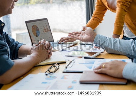 Business concept. Business people discussing the charts and graphs showing the results of their successful teamwork. #1496831909