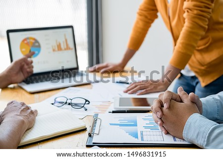 Business concept. Business people discussing the charts and graphs showing the results of their successful teamwork. Royalty-Free Stock Photo #1496831915