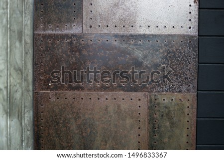 Closeup Polished plaster walls Gouging the rusty iron door and dark stained wood. #1496833367
