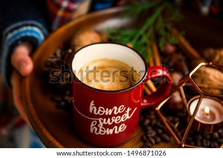 Cozy fall coffee cup with spices,selective focus, candle and autumn decoration in wooden tray, rustic wooden fall still life deco, homey warm deco with coffee cup #1496871026