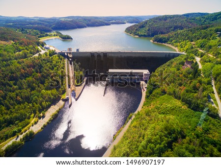 The Orlik Reservoir on Vltava River is largest hydroelectric dam in Czech Republic. Aerial view to important source of sustainable energy in European Union.