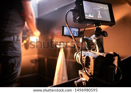 Behind the scenes of filming films or video products and the film crew of the film crew on the set in the pavilion of the film studio. #1496980595