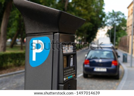 Parking payment machine along the road in a city downtown #1497014639