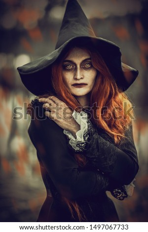 A portrait of an angry witch near the forest. Magic, dark force, spell.  Royalty-Free Stock Photo #1497067733