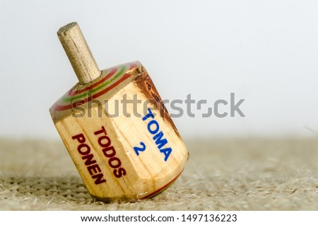 """Traditional pirinola mexican handcrafted wooden toy with titles in spanish """"take all, put one, put two, everyone puts"""" #1497136223"""