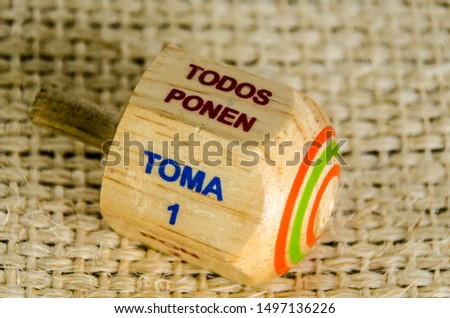 """Traditional pirinola mexican handcrafted wooden toy with titles in spanish """"take all, put one, put two, everyone puts"""" #1497136226"""