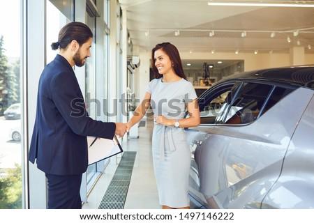 Girl buyer shakes hands dealer car #1497146222