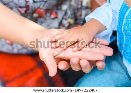 Family holding hands together closeup. Happy together.Gesture sign of support and love, unity togetherness relative people concept. care concept #1497222407