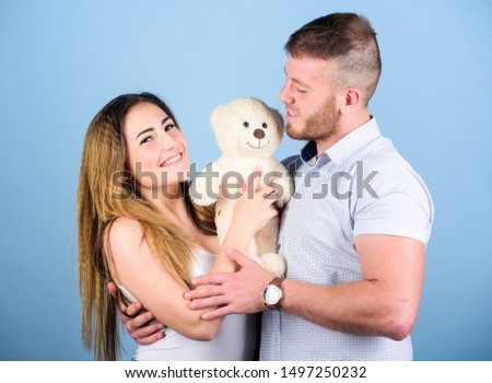 Cute couple. family values. man and woman embrace. romantic relationship. love date. valentines day present. sexy girl and man hold teddy bear. couple in love. family relations and happiness. #1497250232