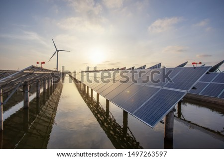 Solar panels and wind power, clean energy in nature Royalty-Free Stock Photo #1497263597