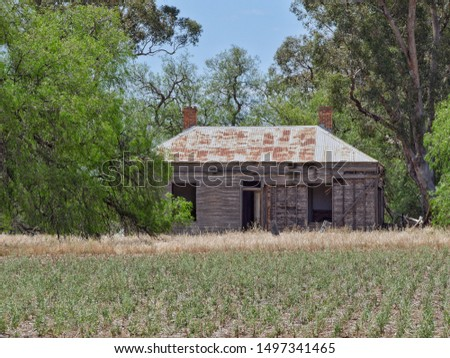 Shelbourne Victoria Australia.  November 26, 2018.  Derelict timber farm house with iron roof overlooking a cropping field in a remote part of Central Victoria #1497341465