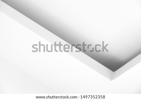 Abstract architecture background photo, white ceiling design with corners and soft shadow. Minimal interior fragment #1497352358