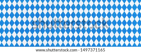 Oktoberfest background frame with bavarian white blue paper, banner. October fest background, text place, copy space. Bavaria State flag fabric table cloth. Oktoberfest cloth paper runner #1497371165