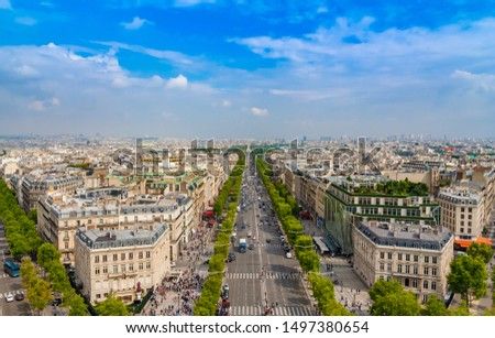 Lovely panoramic aerial view of the famous Avenue des Champs-Élysées in Paris on a nice sunny day with a blue sky at the horizon. It is one of the most recognisable avenues in the world. #1497380654