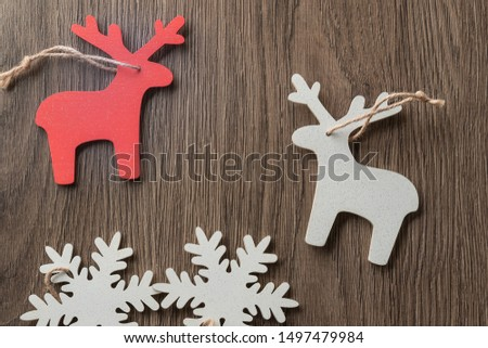 Christmas picture with Santa deers on a dark wooden background