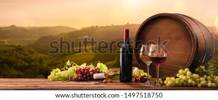 Bottles And Wineglasses With Grapes And Barrel On A Sunny Background. Italy Tuscany #1497518750