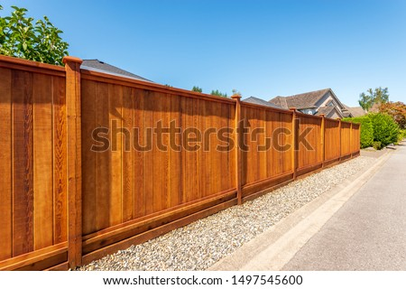 Fence built from wood. Outdoor landscape. Security and privacy concept. Vancouver. Canada. #1497545600