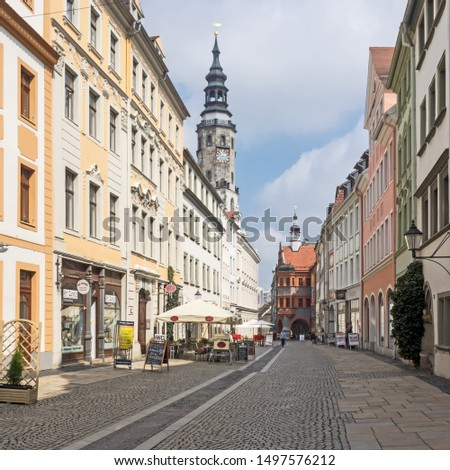"""Goerlitz, Saxony, Germany - 04/18/2018: Historic buildings in the brother street (""""Brüderstraße"""") with Town hall in the background #1497576212"""