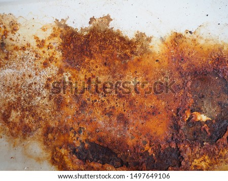 Brown, black and yellow rust and dirt on white enamel. Rusted brown and white abstract texture. Corroded white metal background. Rusty metal surface with streaks of rust. Rusty corrosion.  #1497649106