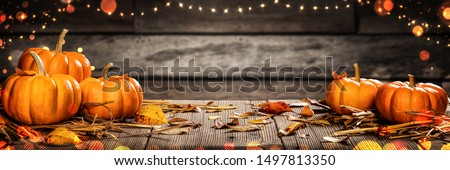 Mini Thanksgiving Pumpkins And Leaves On Rustic Wooden Table With Lights And Bokeh On Wood Background - Thanksgiving / Harvest Concept #1497813350